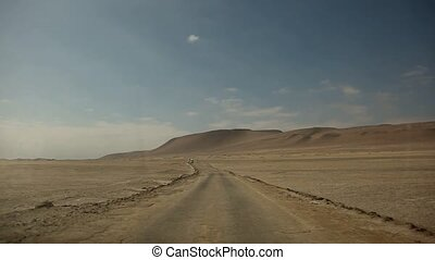 Car in Desert - video footage of a car / bus in a desert,...