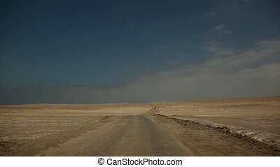 Driving in Desert, Peru - video footage of a car / bus in a...