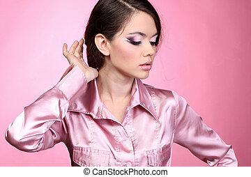 beauty woman with her healthy hair on pink background