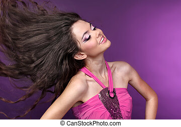 Young happy Beautiful girl dancing in disco-light