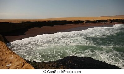 Red Beach, Paracas, Peru - video footage of a coastline in...