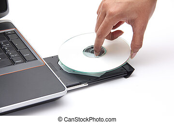 Person placing a compact disc in the cdrom drive - Person...
