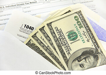Tax forms with dollar bills - Tax forms in an envelope with...