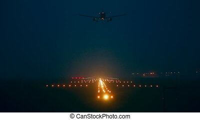 Landing. - jet airplane landing, early morning