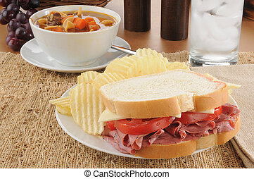 Soup and sandwich - A pastrami sandwich with vegetable soup
