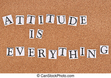 Attitude is everything text on cork-board