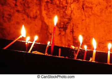 Candles at the Church of the Holy Sepulcher in the Jerusalem...
