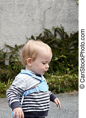 A child walking outdoors