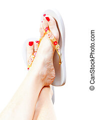 Female legs with flip-flops, isolated on white