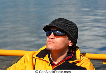 Young man on boat