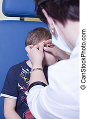 Medical otitus examination of a child at a ear nose throat doctor