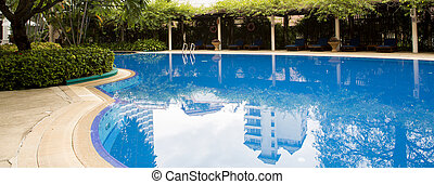 Swimming pool with relaxing seats - Swimming pool with...