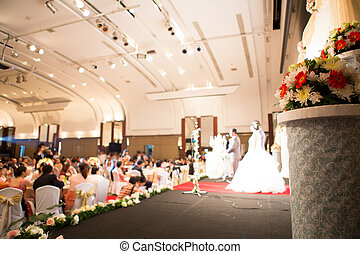 Flowers with a wedding ceremony in background