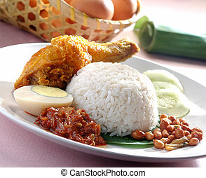 Nasi lemak traditional spicy rice dish - Nasi lemak...