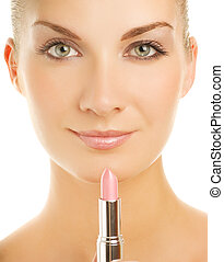 Beautiful young woman with pink lipstick close-up portrait...