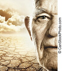Elderly mans face over dry desert land background