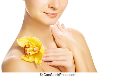 Beautiful young woman with yellow orchid. Isolated on white background
