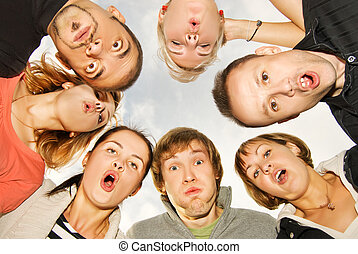 Group of happy friends making surprised faces