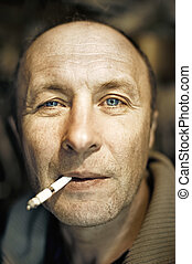 Man with a cigarette close-up portrait