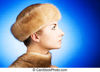 Beautiful young woman in fur cap