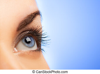 Human eye on blue background shallow DoF