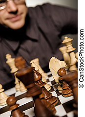 Chess master thinking before making a move shallow Dof,...