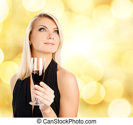Beautiful young woman with a glass of wine over abstract...