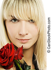 Beautiful young woman with red rose