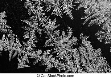 ice crystals detail - frozen water-ice crystals on a black...