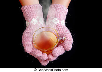 Girl take hot tea in the winter with black background