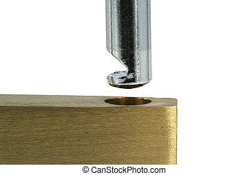 Isolated Brass open lock on white macro