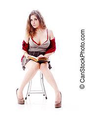 Sexy school girl - One sexy school girl reading a book