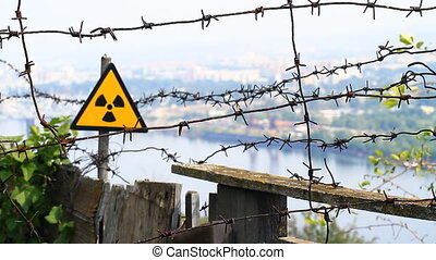 Barbed wire. - Radioactivity Sign and barbed wire.
