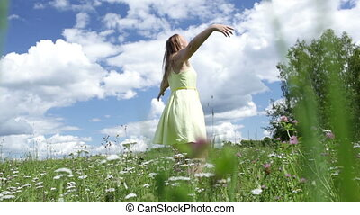 Girl is dancing in the field