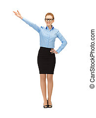 attractive businesswoman pointing her hand - picture of...