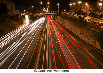 Busy highway - overview of a highway at night with multiple...