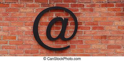 At sign on brick