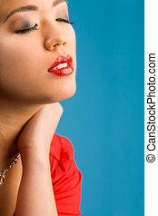 Closed glamour eyes - Young chinese girl on a blue...