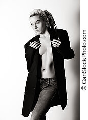 implied nude - sexy woman with dreadlocks wearing man jeans...