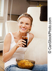 smiling teenage girl with chips and coke - picture of...