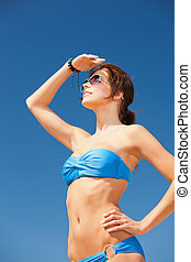 happy woman in sunglasses on the beach - picture of happy...
