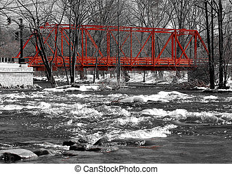 Wrought iron truss bridge, river view, winter scene
