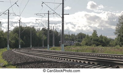 Electric train to the viewer. - Electric train is turning...