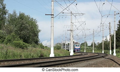 Blue train. - Modern passenger blue train is passing by. No...
