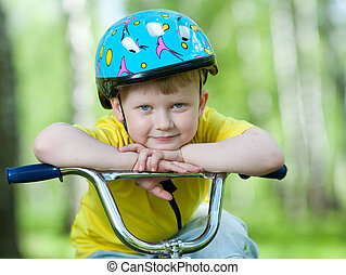 Portrait of a cute child on bicycle