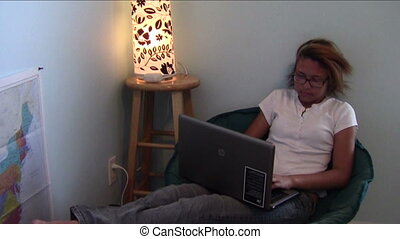 Homeschool Comfort - Homeschool student using computer while...