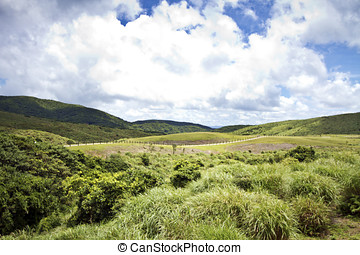 hill - Grass Mountain and blue cloudy sky background located...