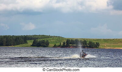 Jet-ski on lake in summer day - Jet ski above water on lake...