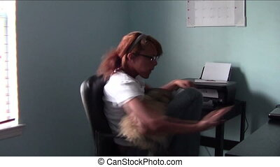 Chair Spinning Fun - Homeschool student holding dog while...