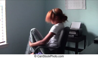 Chair Spinning Fun - Homeschool student spinning in office...